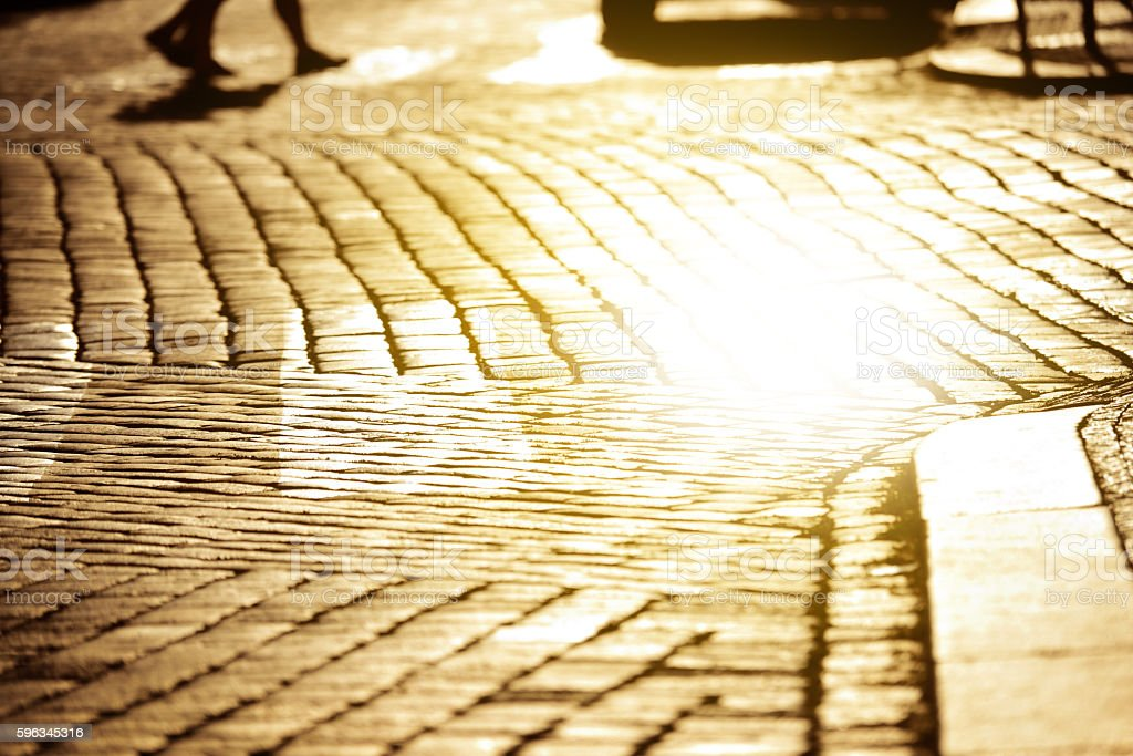 Cobble stone street reflecting sunset sun royalty-free stock photo