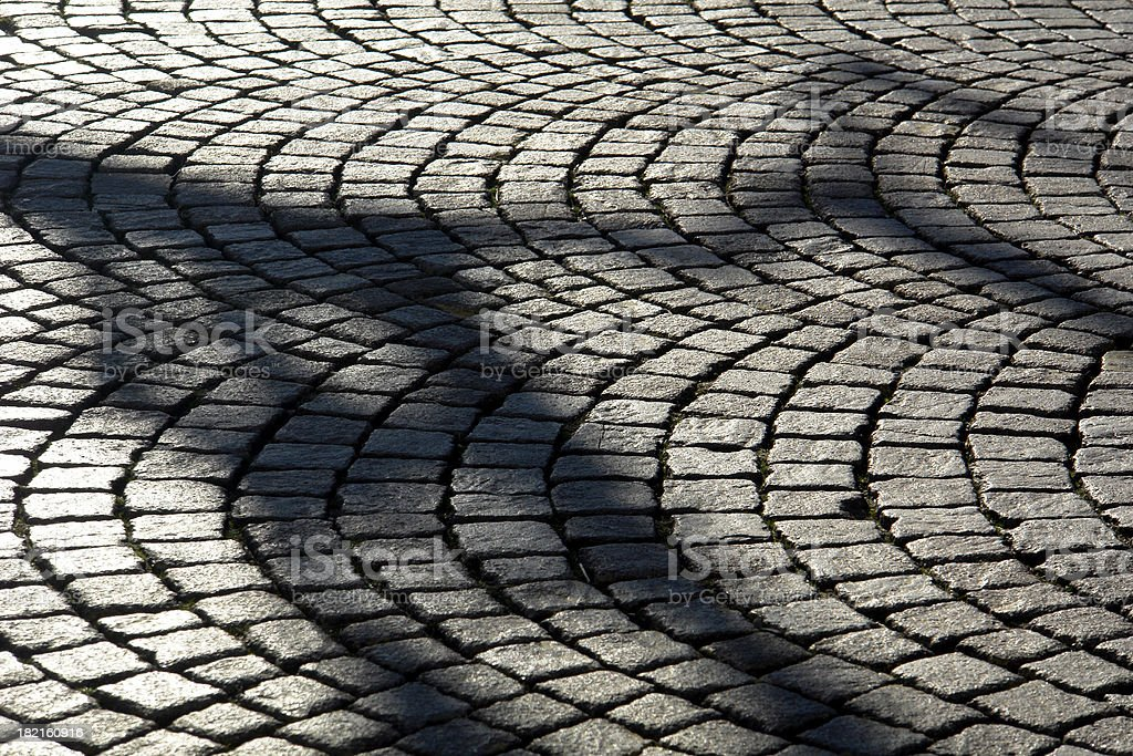 Cobbled Road with a Shadow of... royalty-free stock photo