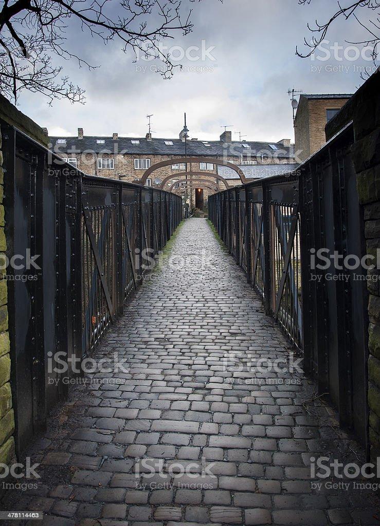 cobbled stone footbridge stock photo