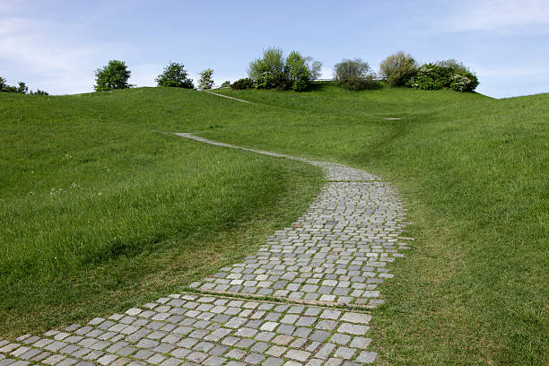 cobbled stone path on a slope stock photo