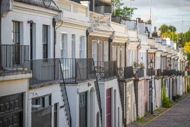 A cobbled street around Holland Park mews in London Rows of terraced houses on cobbled Holland Park Mews in London central london stock pictures, royalty-free photos & images