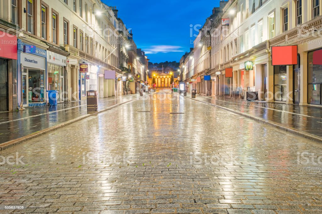 Cobbled street with storefronts in downtown Dundee Scotland UK stock photo