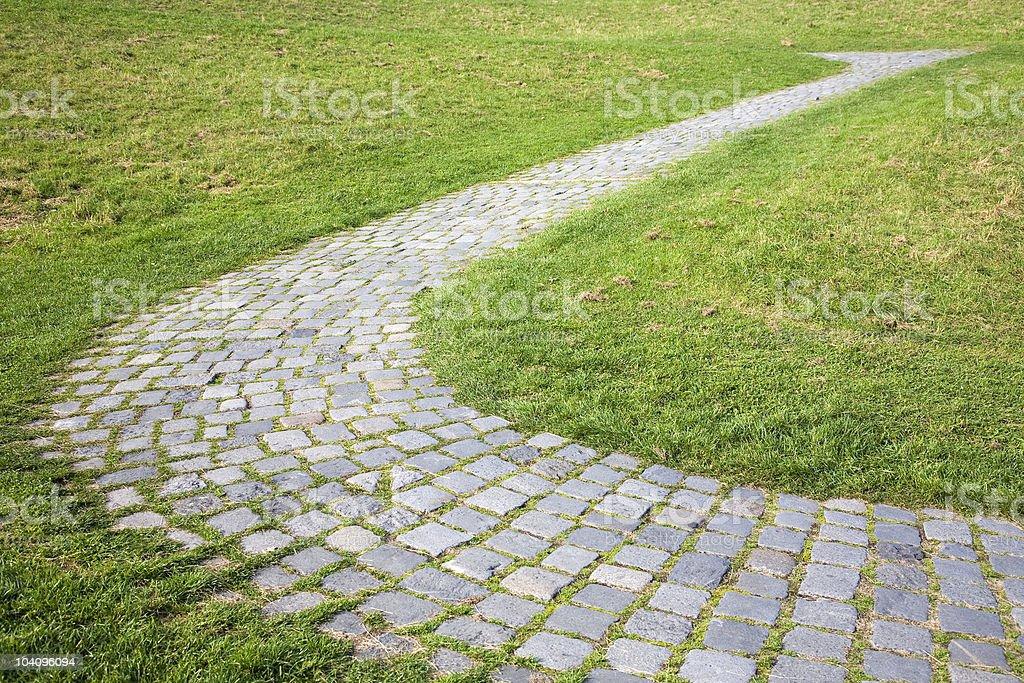 cobbledstone path s-curve stock photo