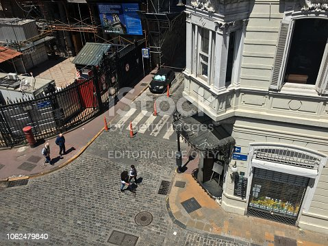 Buenos Aires, Argentina - Octubre 27, 2018: High angle view of street corner in the old town district of the city. The area is undergoing permanent restoration as can be seen to the left of the image
