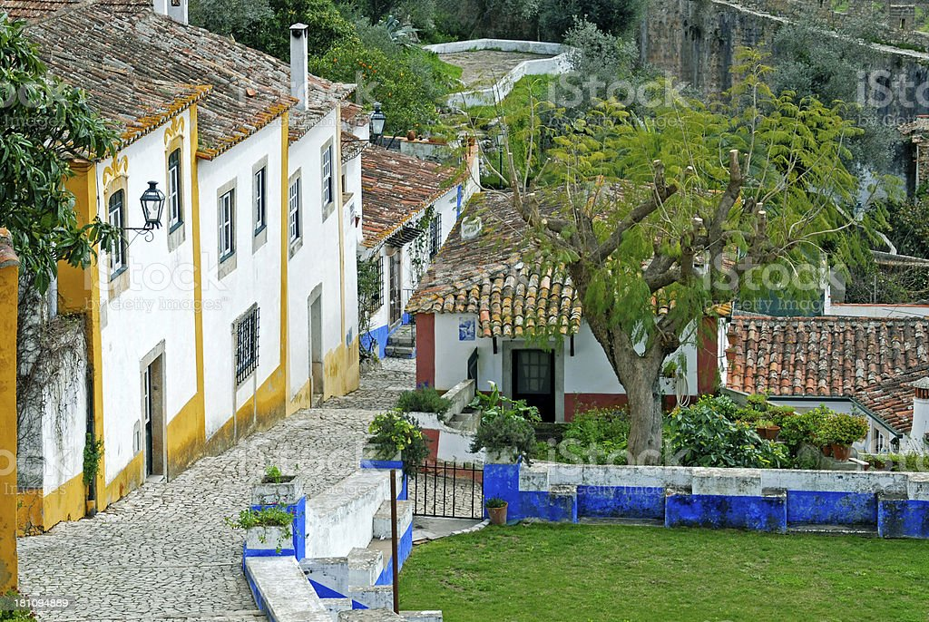 Cobblestone path in walled Portuguese town of Obidos royalty-free stock photo