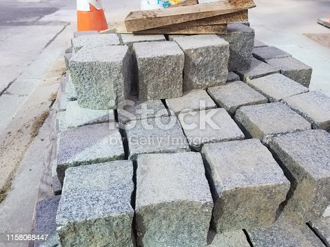 Pallet with stack of new cobblestone pavers at a construction site, June 18, 2019