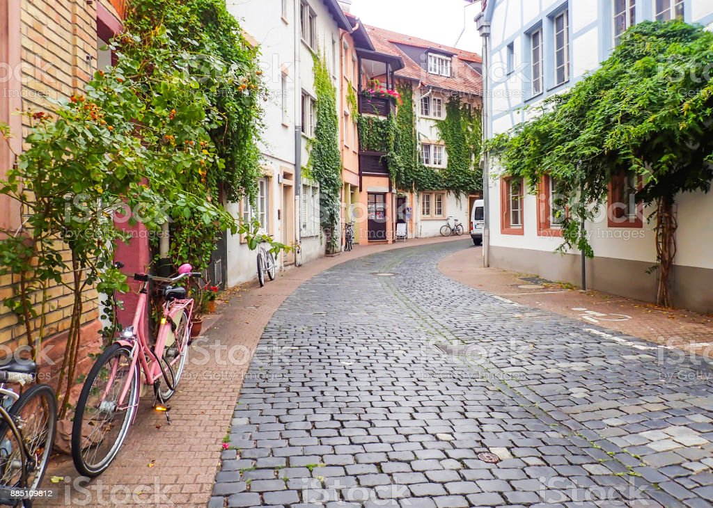 Cobblestone Road in Heidelberg with Pink Bicycle in Foreground stock photo