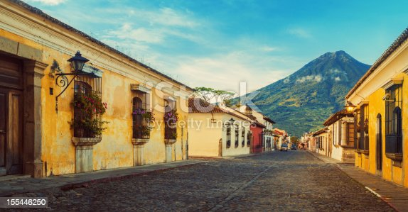 Cobblestone street in Antigua, Guatemala - Acatenango volcano in the back