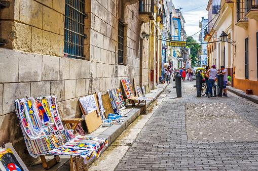 July 31, 2018 - La Havana, Cuba: tourists and souvenirs in Empedrado street in front of La Bodeguita del Medio bar in old Havana, Cuba