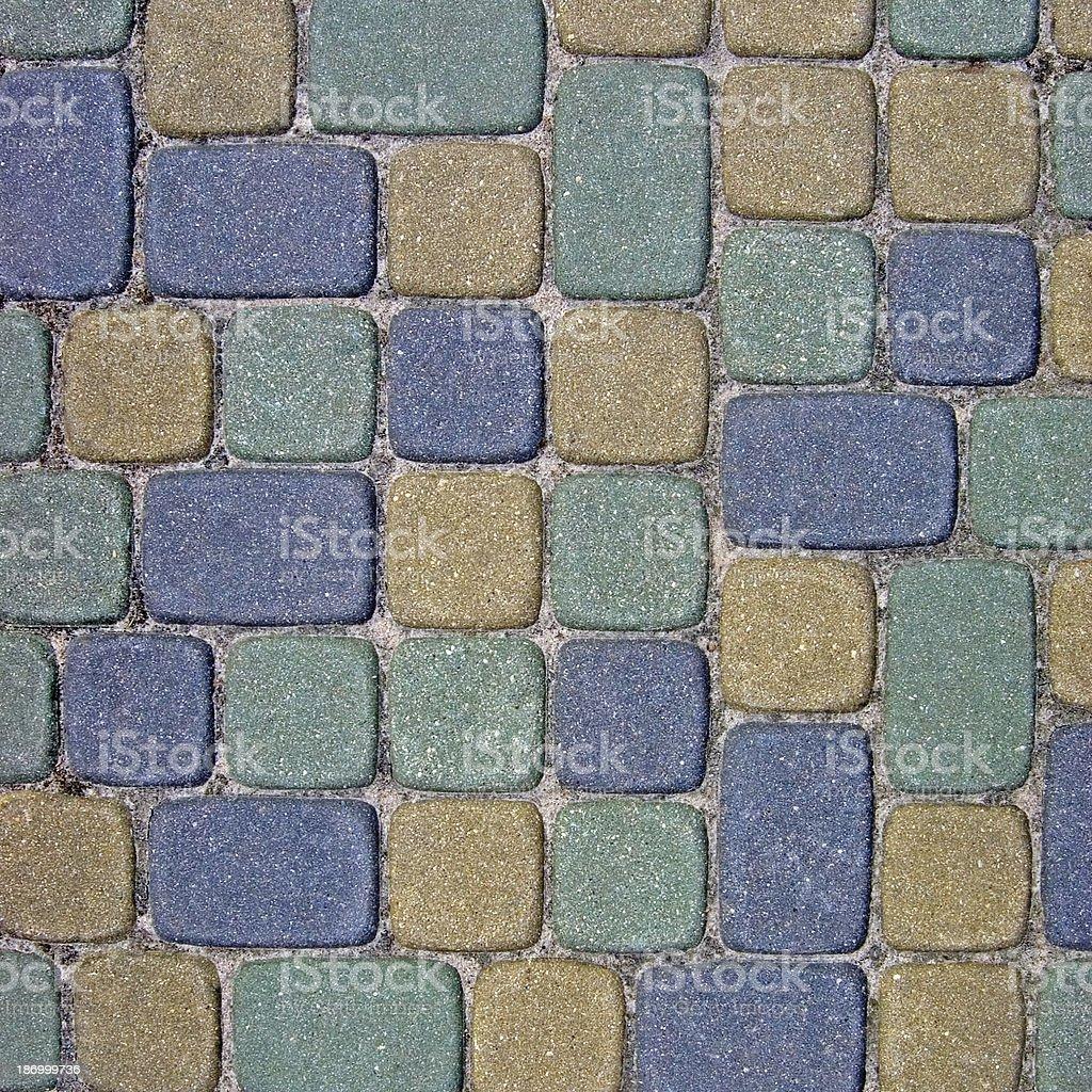 Cobblestone Texture Background Closeup green, yellow, blue ashlar sidewalk footpath royalty-free stock photo