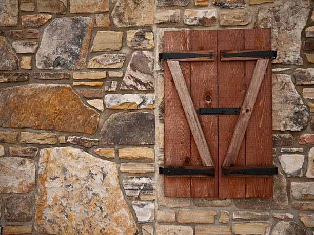 Cobblestone Wall and Shutters stock photo