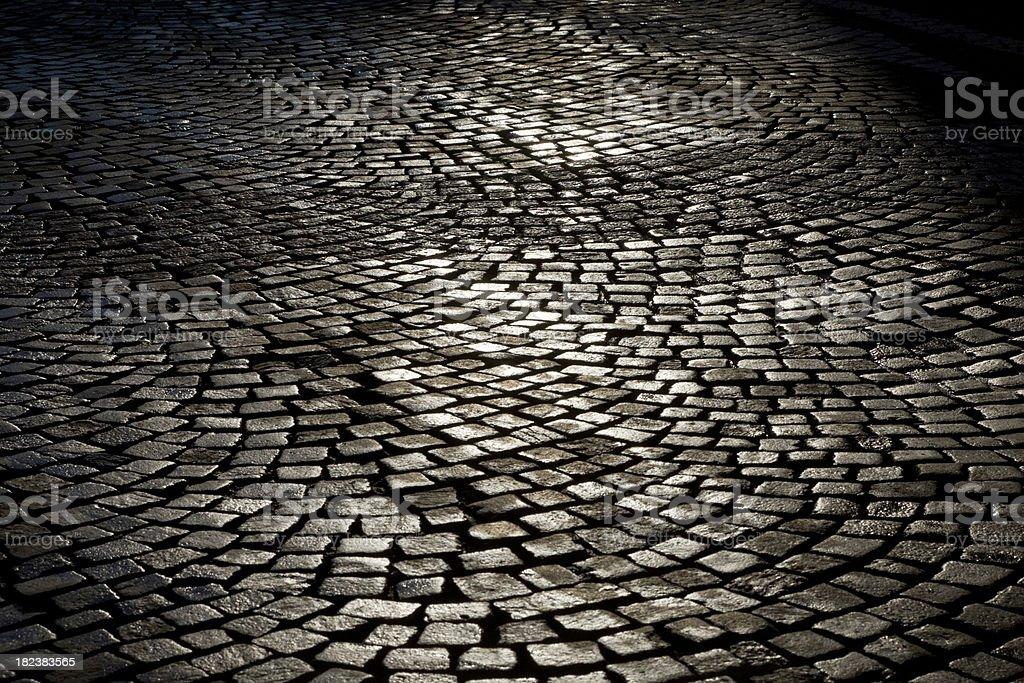 Cobblestones backlit royalty-free stock photo