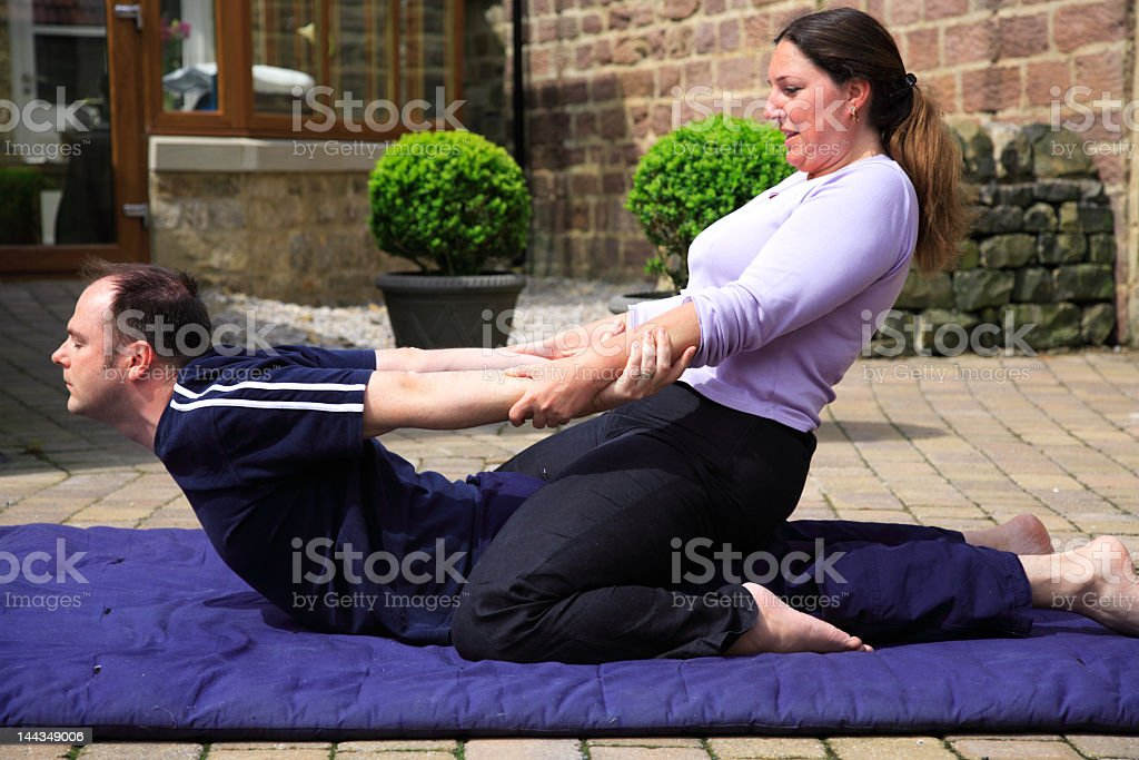 Cobra pose from traditional Thai Body Massage stock photo
