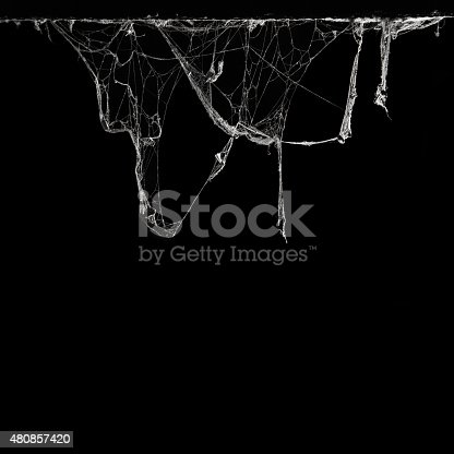 istock cobweb spider web in ancient thai house isolated on black 480857420