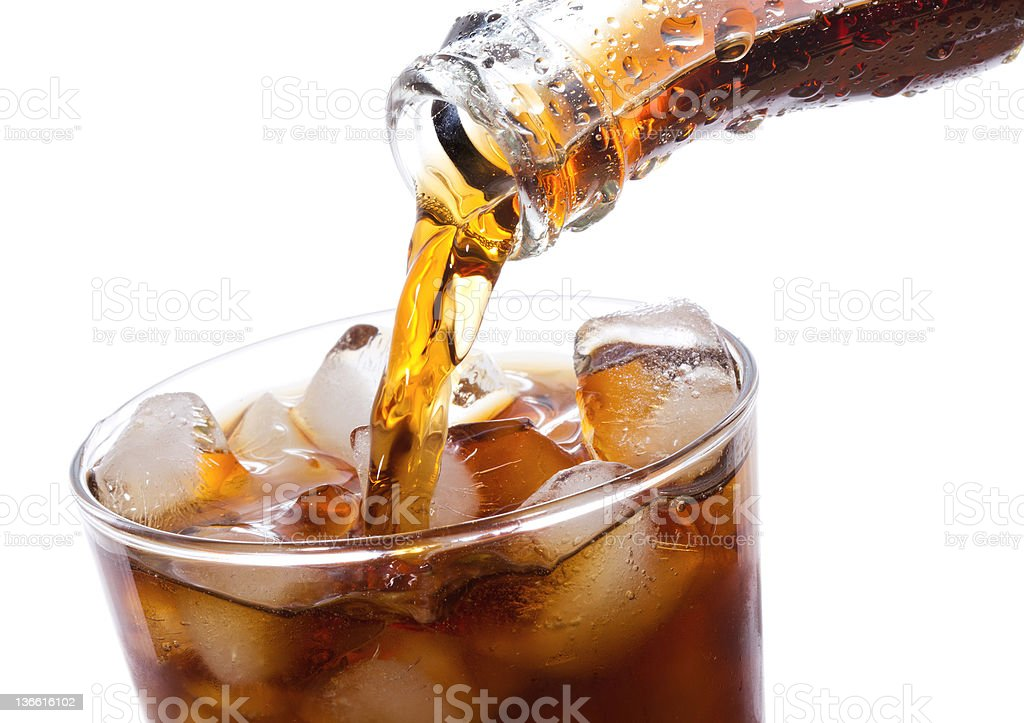 Coca Cola being poured into glass royalty-free stock photo