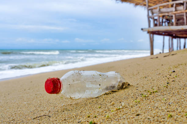 Coca Cola plastic bottle garbage pollution on beach stock photo