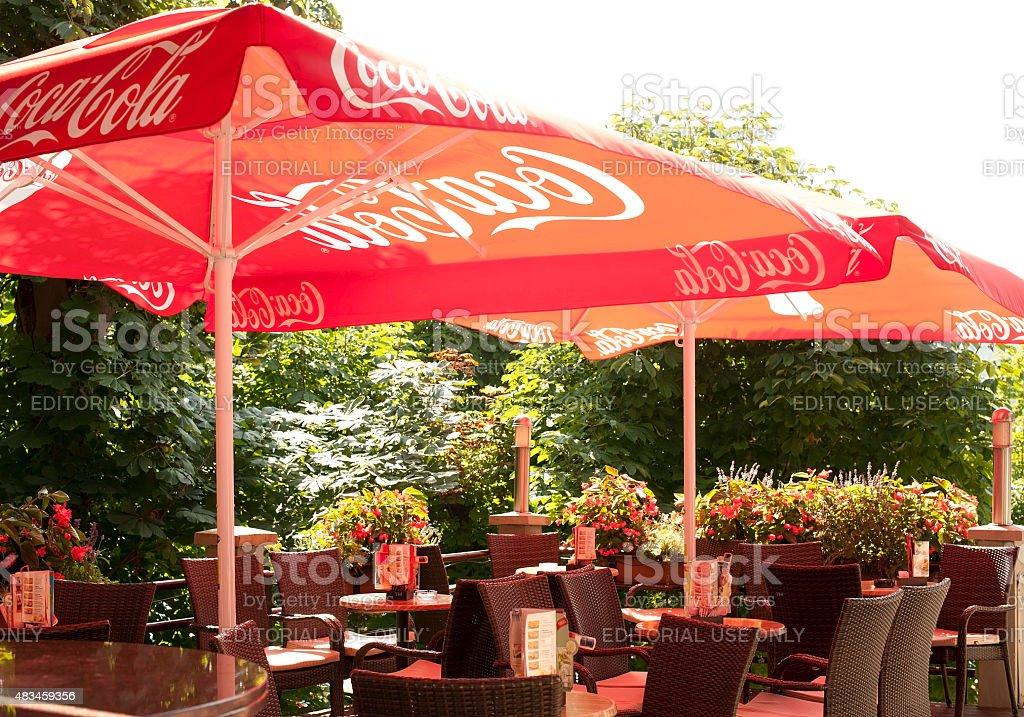 Coca Cola Umbrellas In An Outdoors Bar In Bled Slovenia Stock Photo