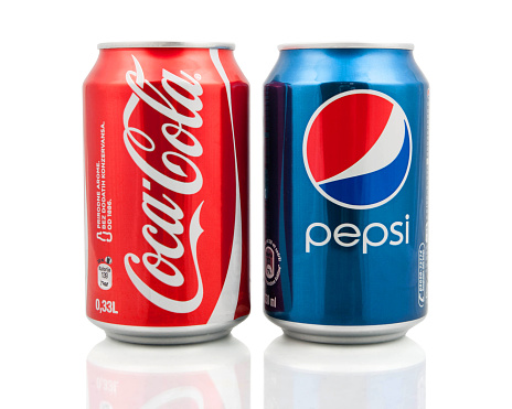 Kragujevac, Serbia - January 27, 2014: Coca-Cola and Pepsi cans on white background. Symbolic representation of one of the greatest business rivalries of all time.