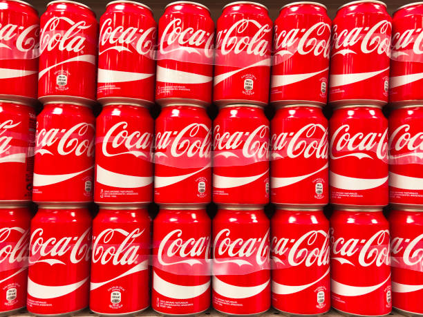 Coca-Cola cans in rows stock photo