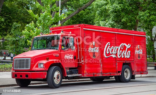 Red CocaCola Delivery Truck Parked on a street in the Beaches area of Toronto Ontario Canada on a Summer day