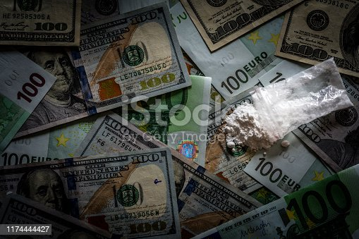Euro is in the wallet next to the condoms. European union money lies in a wallet on a wooden table.
