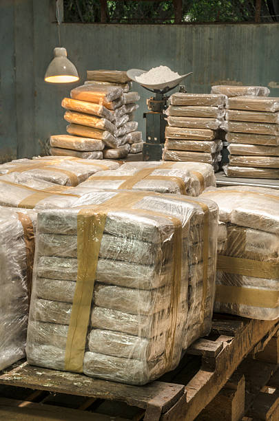 Cocaine packets This is a scene arranged by photographer to recreate an illegal warehouse.  cocaine stock pictures, royalty-free photos & images