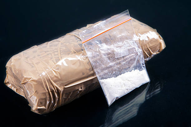 Cocaine powder Cocaine powder in plastic bag with a packages cocaine stock pictures, royalty-free photos & images
