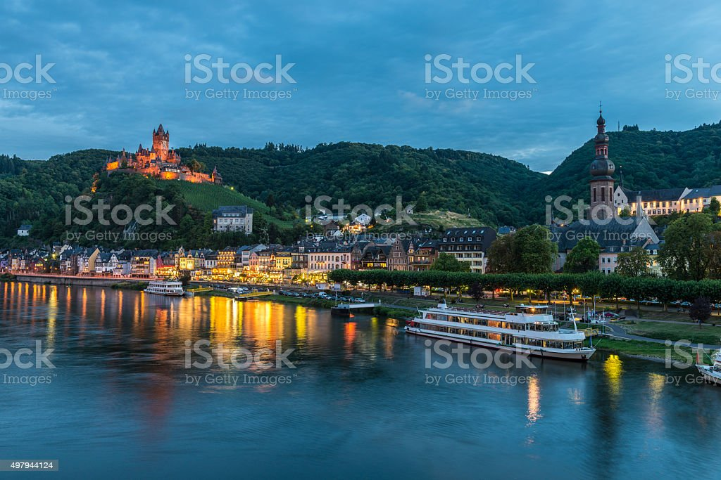 Cochem, Mosel River, Germany illuminated at dusk stock photo
