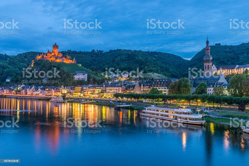 Cochem, Mosel River, Germany illuminated at dusk​​​ foto