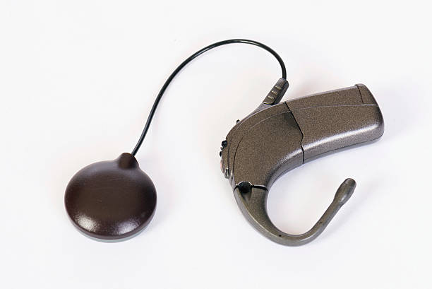 Cochlear implant Cochlear implant device for deaf or hearing impaired people implant stock pictures, royalty-free photos & images