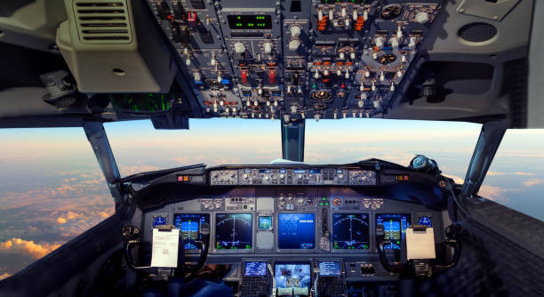 cockpit airplane flying above tropical sunset - cockpit stock photos and pictures