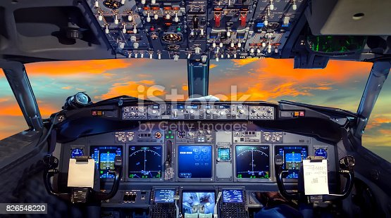 airplane cockpit Flight Deck in sunset