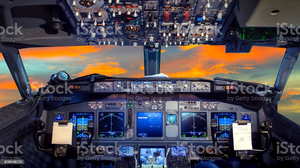 cockpit Flight Deck sunset stock photo