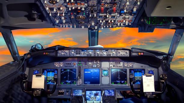 cockpit flight deck sunset - cockpit stock photos and pictures