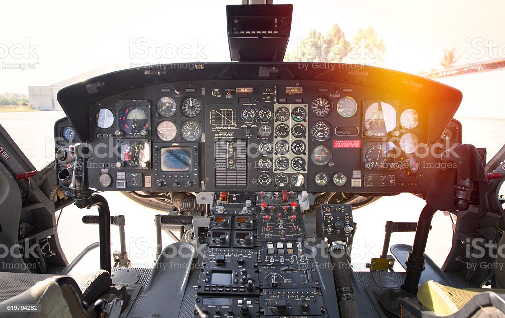Cockpit helicopter - Instruments panel. Interior of helicopter control dashboard stock photo