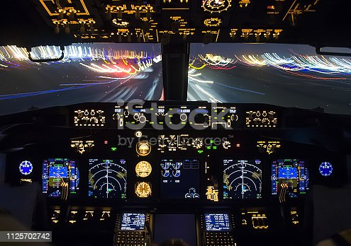 istock Cockpit of a passenger plane. View from the cockpit during 1125702742