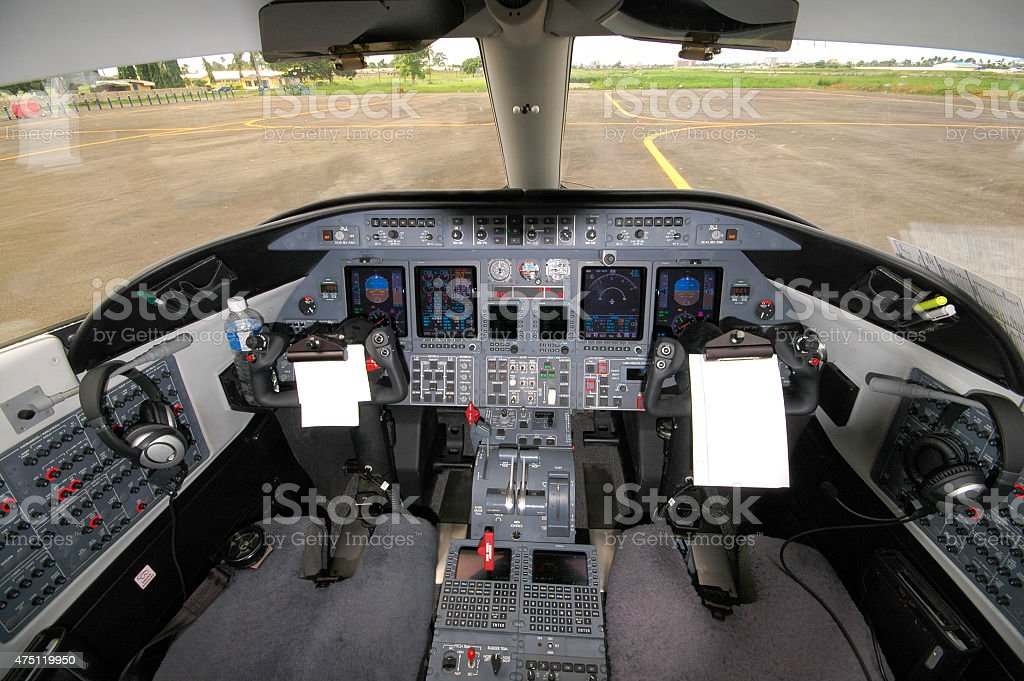 Cockpit of a Private jet. On Tarmac. No people. stock photo