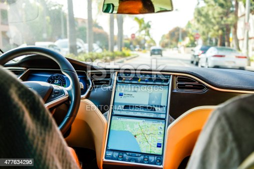 Los Angeles, United States - May 17, 2013: A cockpit with LCD digital speedometer and LCD touch screen of electric car Tesla Model S during drive in Santa Monica, Los Angeles, California. Tesla electric cars are produced by Tesla Motors, Inc. in California, USA.