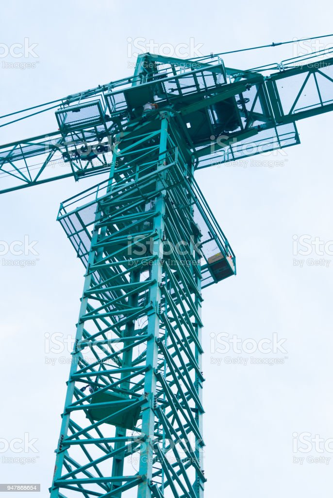 Cockpit photographed from the ground of a green crane in a construction site-2 stock photo