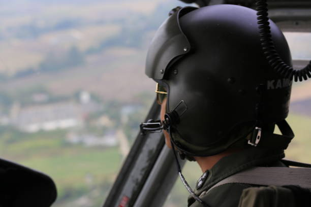 cockpit view helicopter pilot in flight cockpit view helicopter pilot in flight flight suit stock pictures, royalty-free photos & images
