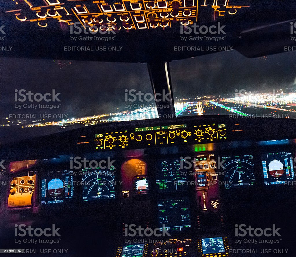 Cockpit view of a commercial jet aircraft  landing stock photo