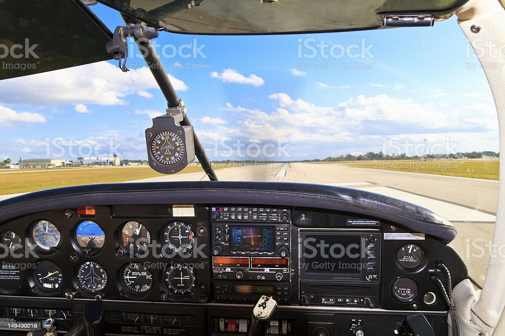 Cockpit view - Small aircraft taking off from runway stock photo