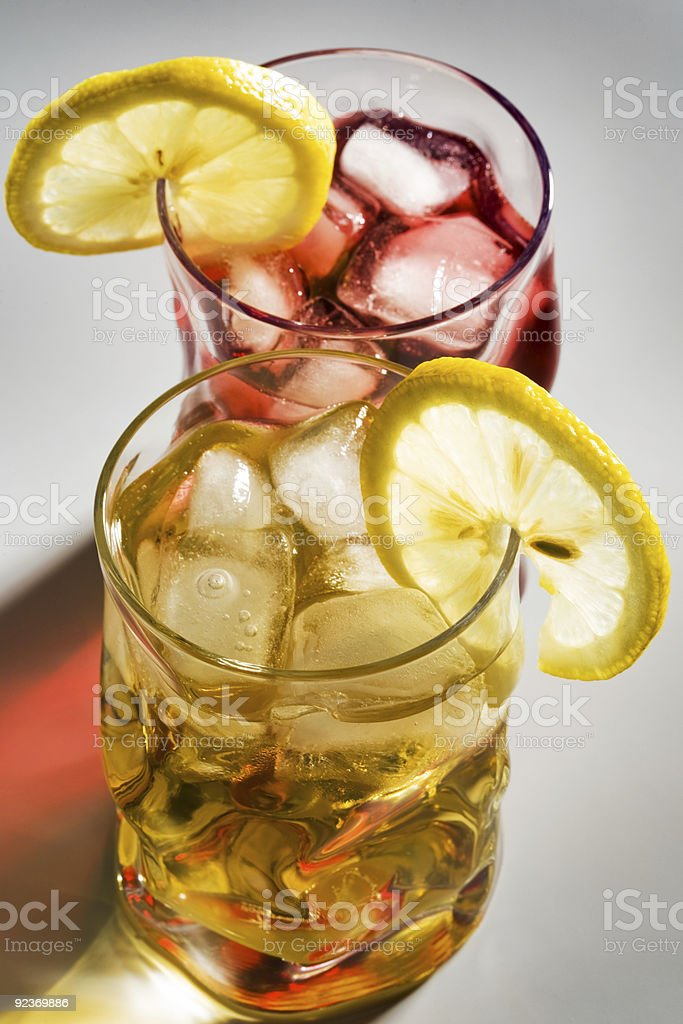 cocktail, a lemon and an ice royalty-free stock photo