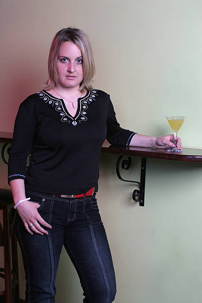 Cocktail and provocative pose stock photo