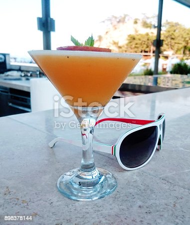31becad03d2 Cocktail And Sunglasses On A Bar Counter Stock Photo & More Pictures of  Alcohol