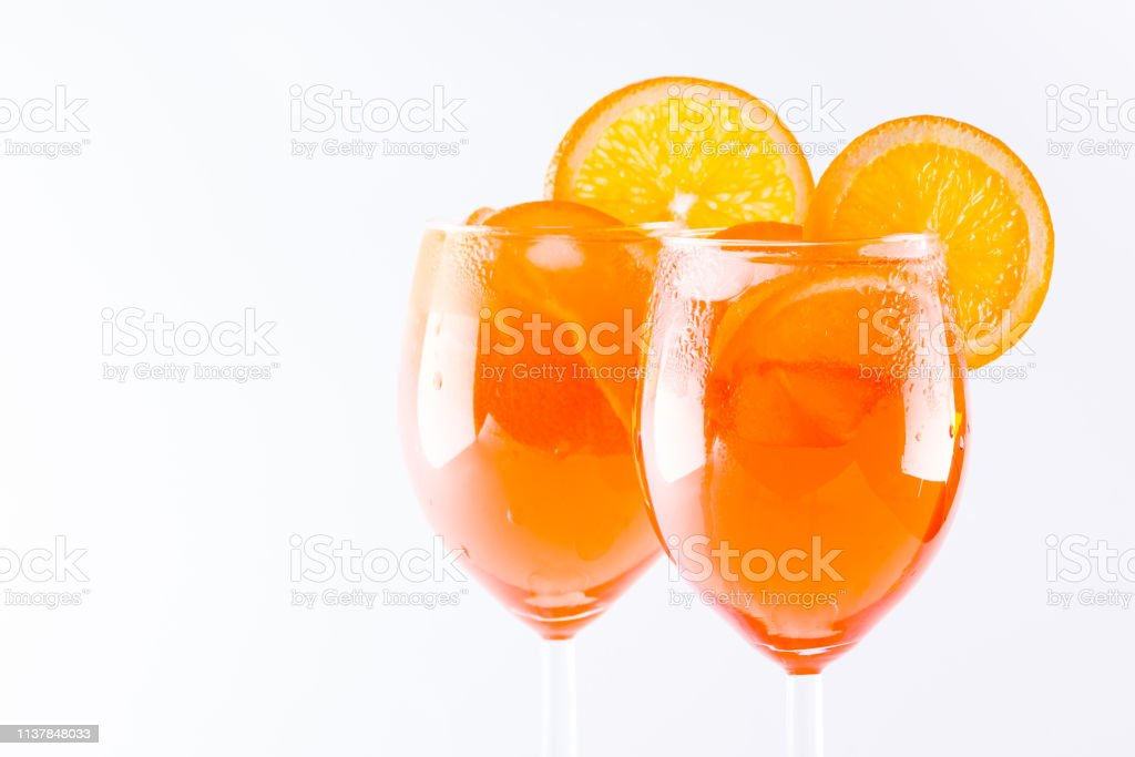 Cocktail aperol spritz on white background. Summer alcoholic cocktail...