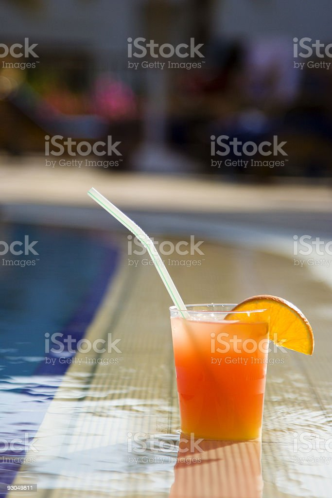 Cocktail at the edge of pool royalty-free stock photo