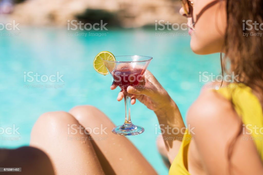 Cocktail by the pool stock photo