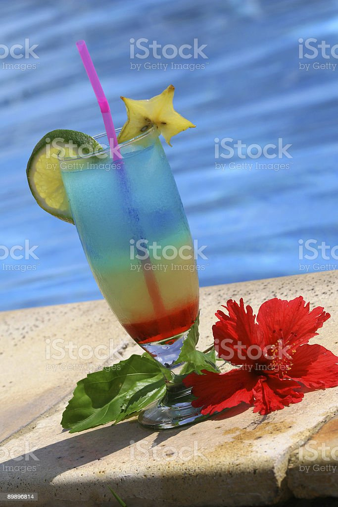 cocktail by the swimming pool royalty-free stock photo