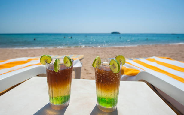 cocktail drinks on beach at luxury tropical hotel beach - horn of africa stock photos and pictures